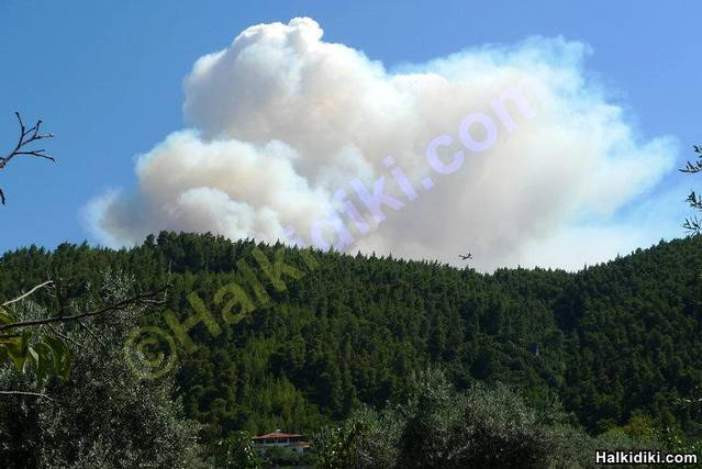 Small fire in Sithonia as seen from Sithonia (Vourvourou)